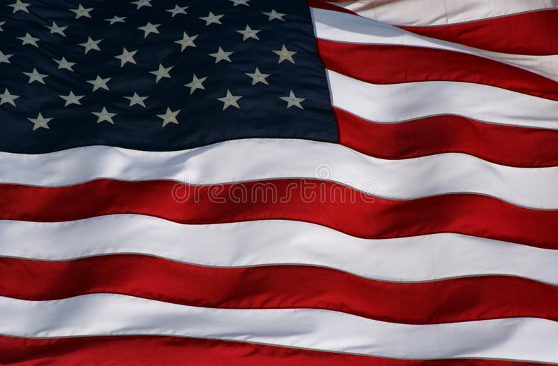 Rippling US flag. Close up shot of a rippling US flag royalty free stock photos