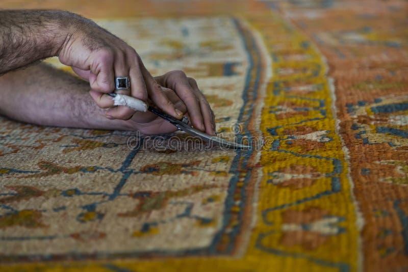 Ripristino del tappeto immagine stock
