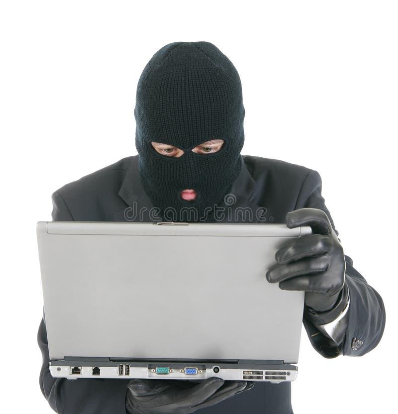 Riprogrammatore di calcolatore - criminale con il computer portatile fotografie stock