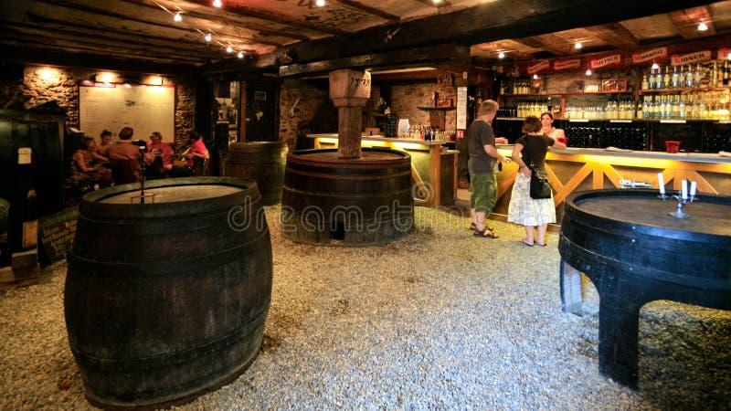 Tourists taste local wine in Riquewihr in Alsace stock image