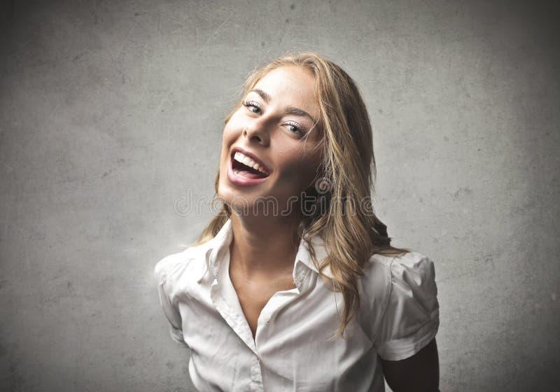 Rire éclatant blond photographie stock