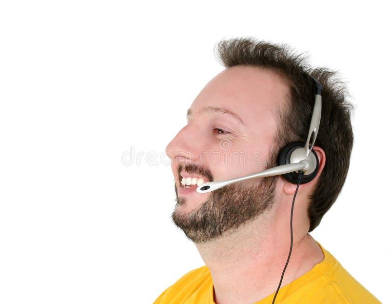 Rire d'homme de support de volontaire ou de téléphone de centre de crise image stock