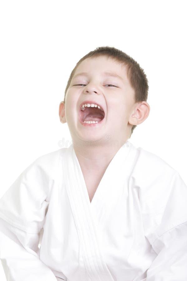 Rire peu de gosse de karaté photo libre de droits