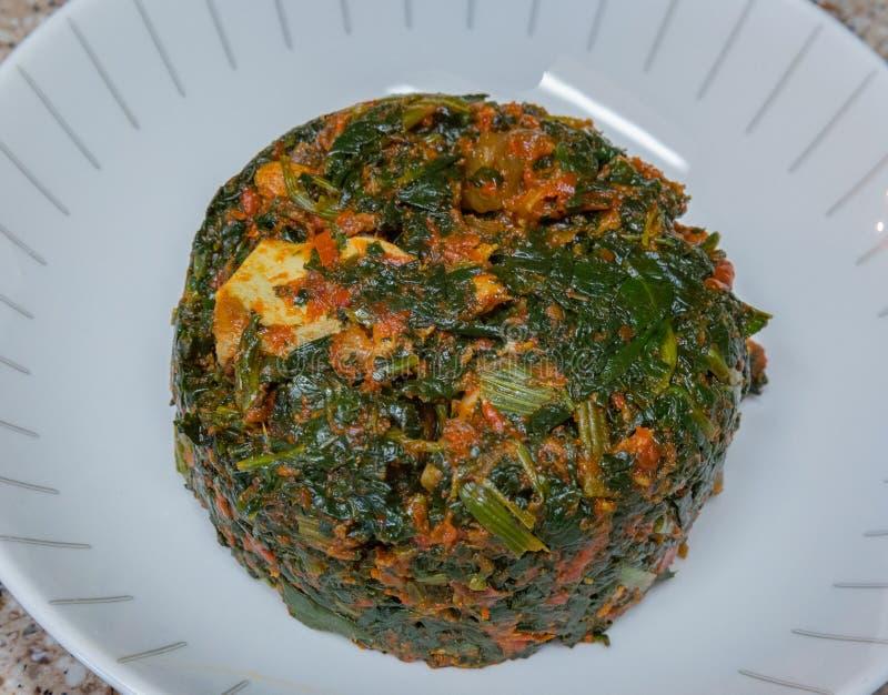 Riro Efo με το κρέας αιγών στοκ εικόνες