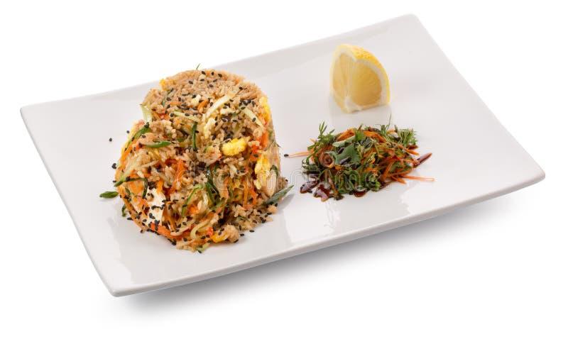 Ris med kryddor och grönsaker arkivfoto
