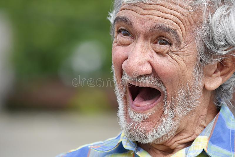 Risa del varón adulto del Latino imagen de archivo libre de regalías