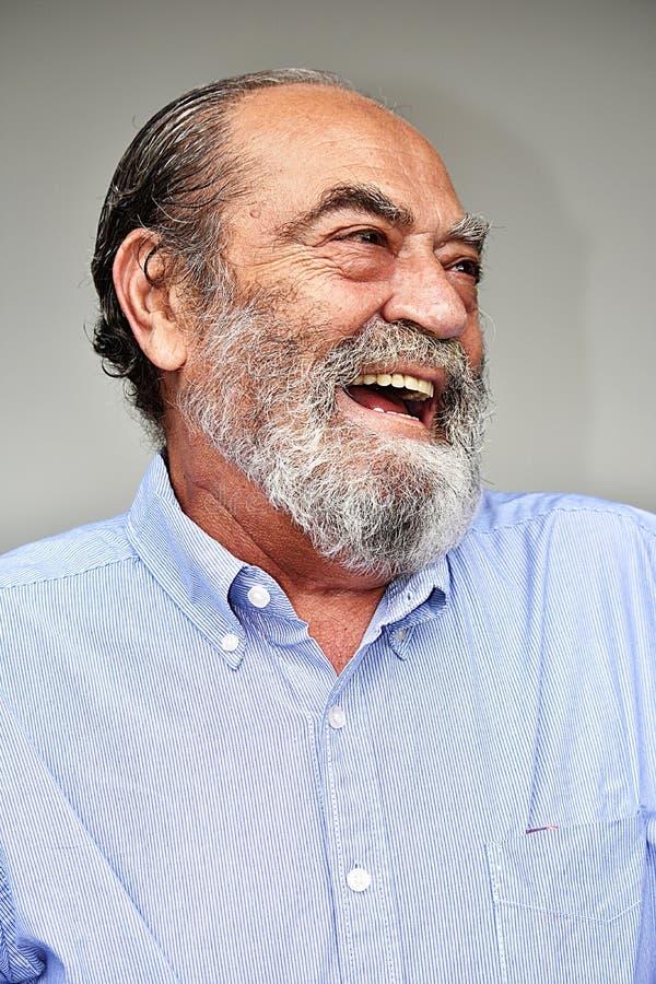 Risa del varón del Latino foto de archivo libre de regalías
