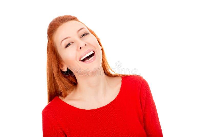 Risa hermosa de la mujer feliz mirándole cámara imagenes de archivo
