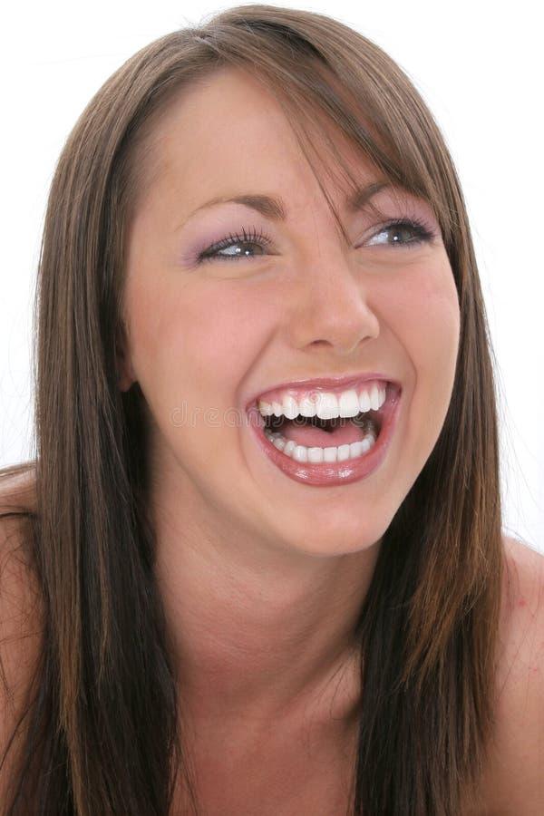 Risa hermosa de la mujer joven imagenes de archivo