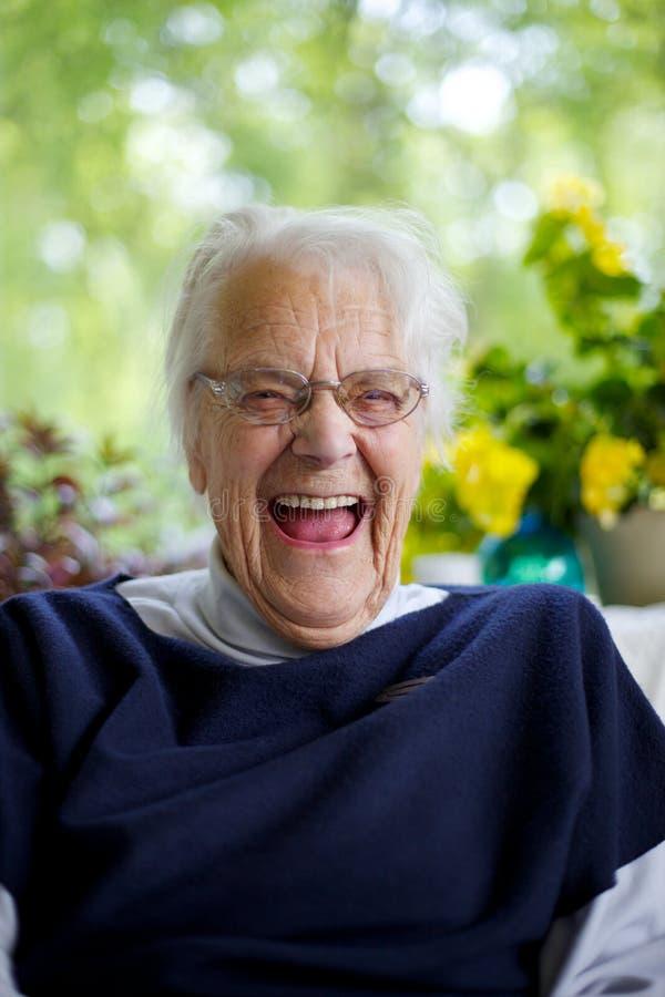 Risa mayor de la mujer imagenes de archivo