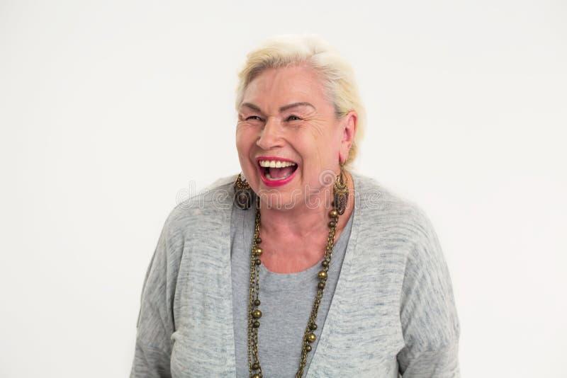 Risa mayor de la señora aislada imágenes de archivo libres de regalías
