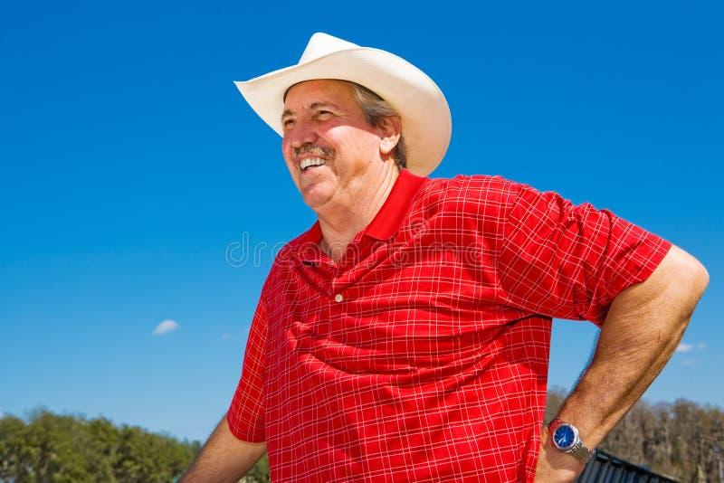 Risata matura del cowboy fotografie stock