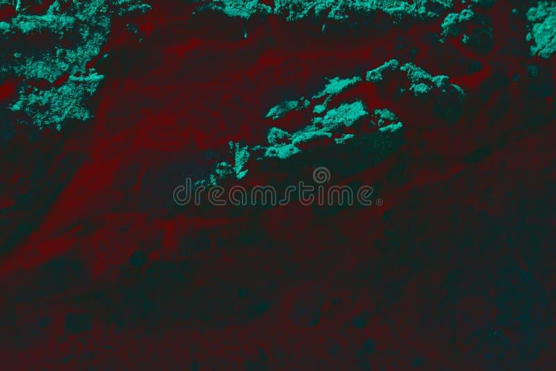 Riscaldi la struttura al suolo incrinata rossa dopo il vulcano di eruzione fotografia stock