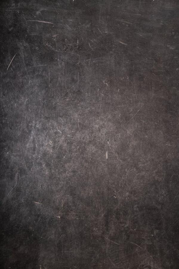 Riscos em uma superfície suja cinzenta fotografia de stock