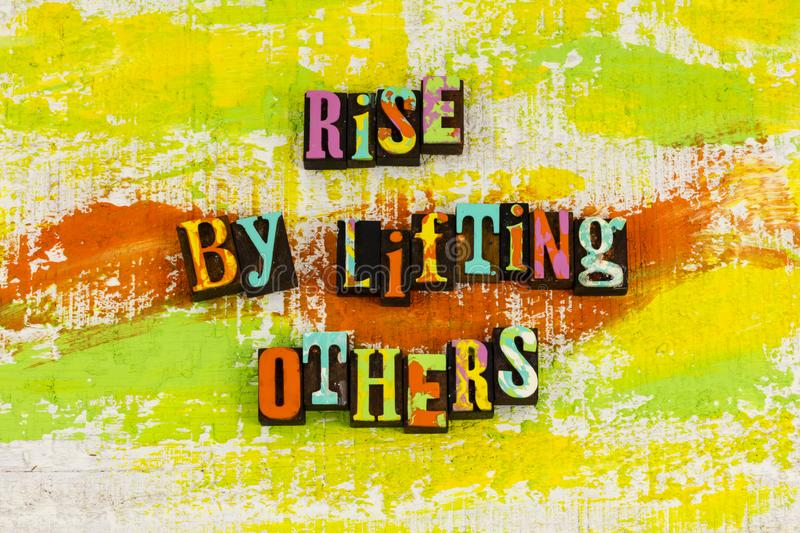 Rise by lifting others helping stock photo