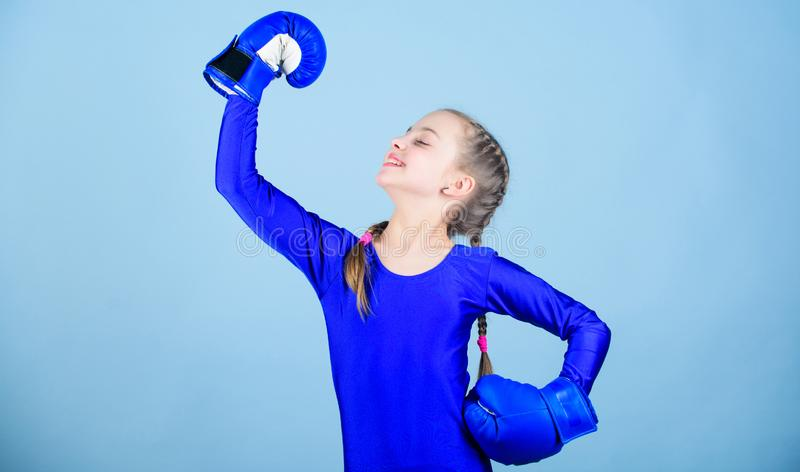 Rise of women boxers. Female boxer change attitudes within sport. Free and confident. Girl cute boxer on blue background. Rise of woman boxers. Female boxer stock images