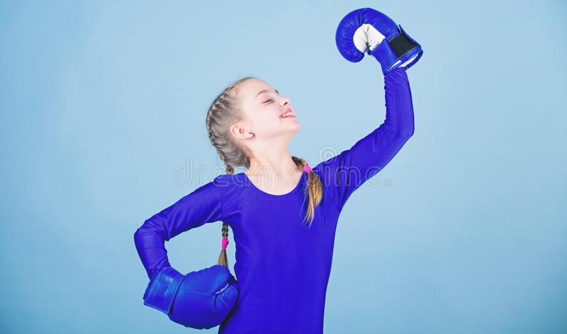 Rise of women boxers. Female boxer change attitudes within sport. Free and confident. Girl cute boxer on blue background. Rise of woman boxers. Female boxer royalty free stock photography