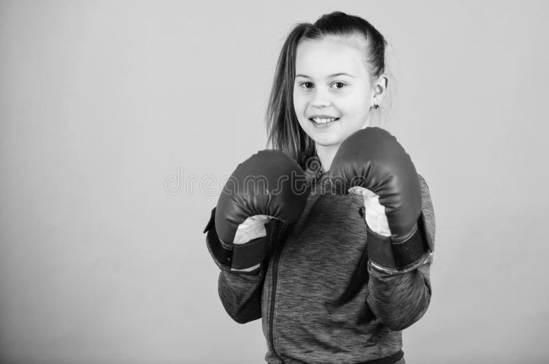 Rise of women boxers. Girl cute boxer on blue background. With great power comes great responsibility. Contrary to. Rise of woman boxers. Girl cute boxer on blue royalty free stock photography