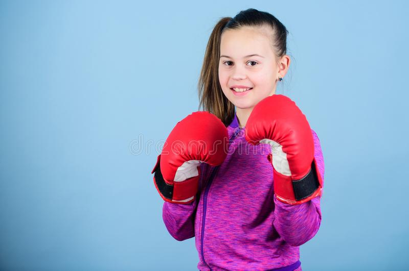 Rise of women boxers. Girl cute boxer on blue background. With great power comes great responsibility. Contrary to. Rise of woman boxers. Girl cute boxer on blue royalty free stock images