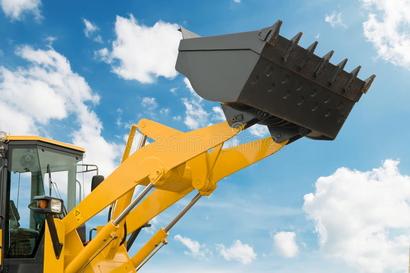 Risen loader shovel stock photos