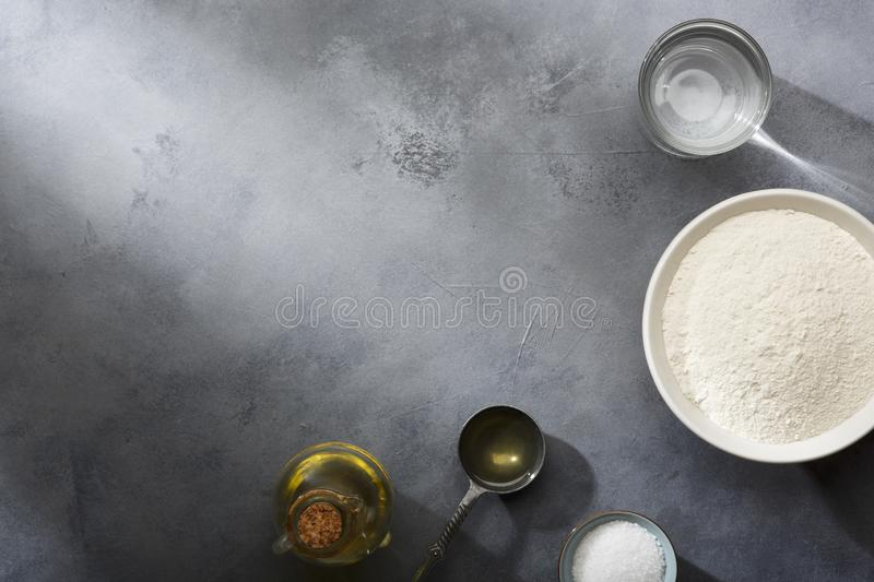 Risen or proved yeast dough for bread or pizza on a floured slate surface. Top view royalty free stock photo
