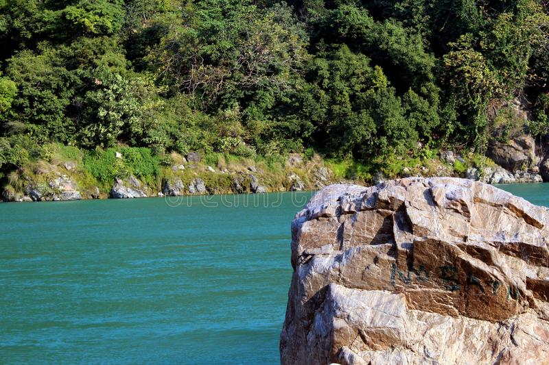 Natural Image. Rishikesh. Rishikesh, a most tranquil place in northern Uttarakhand, surrounded by hills and bisected by the wide and sluggish Ganges, is often royalty free stock image