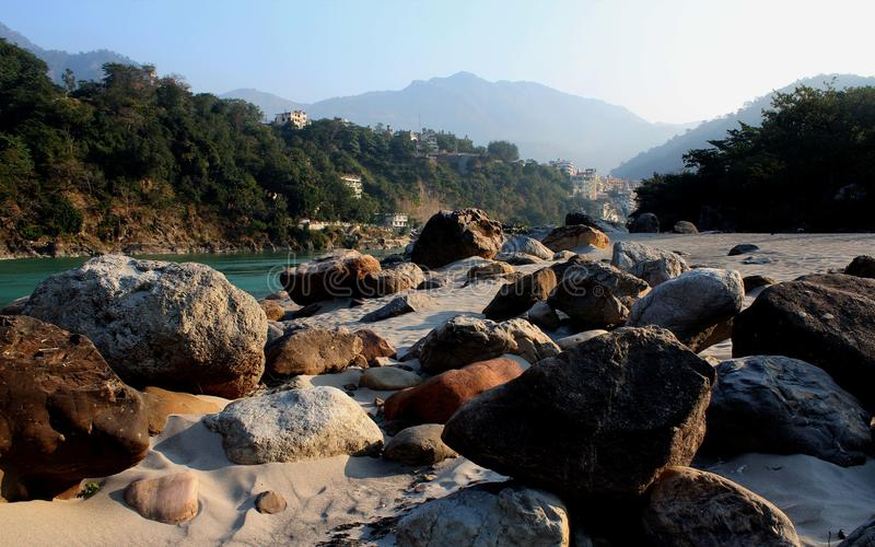 Natural Image. Rishikesh. Rishikesh, a most tranquil place in northern Uttarakhand, surrounded by hills and bisected by the wide and sluggish Ganges, is often stock photography
