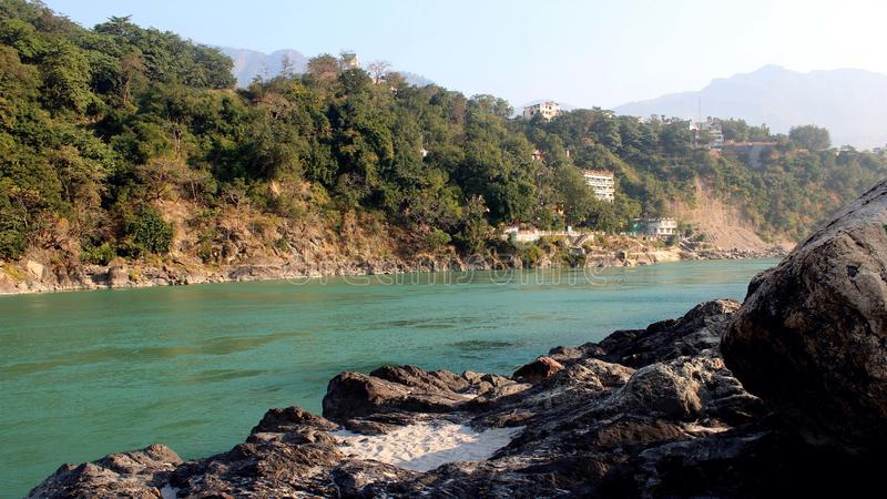 Natural Image. Rishikesh. Rishikesh, a most tranquil place in northern Uttarakhand, surrounded by hills and bisected by the wide and sluggish Ganges, is often stock images