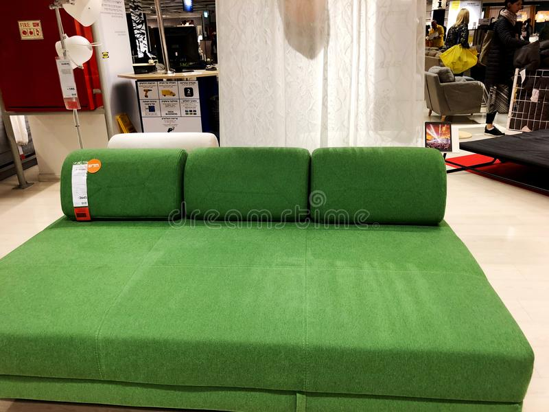 Rishon Le Zion, Israel - December 16, 2017: Green sofa. Soft velvet fabric. Classic modern sofa sold in the store royalty free stock image