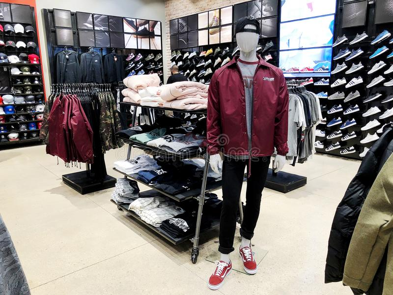 RISHON LE ZION, ISRAEL- DECEMBER 17, 2017: Modern clothes in a shop on a hanger in shopping center in Rishon Le Zion, Israel. royalty free stock photo