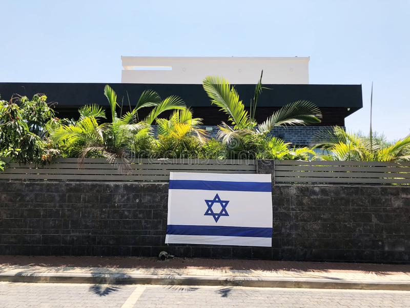 RISHON LE ZION, ISRAEL - June 27, 2018 Israel`s national flag, which is a private home fence in Rishon Le Zion, Israel.  stock photography