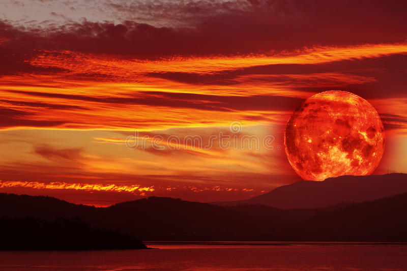 Rising blood red moon royalty free stock photography