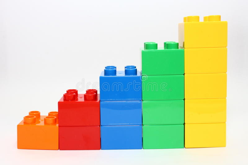 Rising building blocks. Representing growing sales or rising figures royalty free stock photos