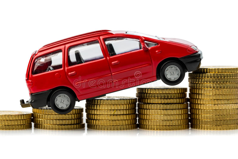 Rising car costs. car on coins. Rising costs in the car by workshop costs stock photography