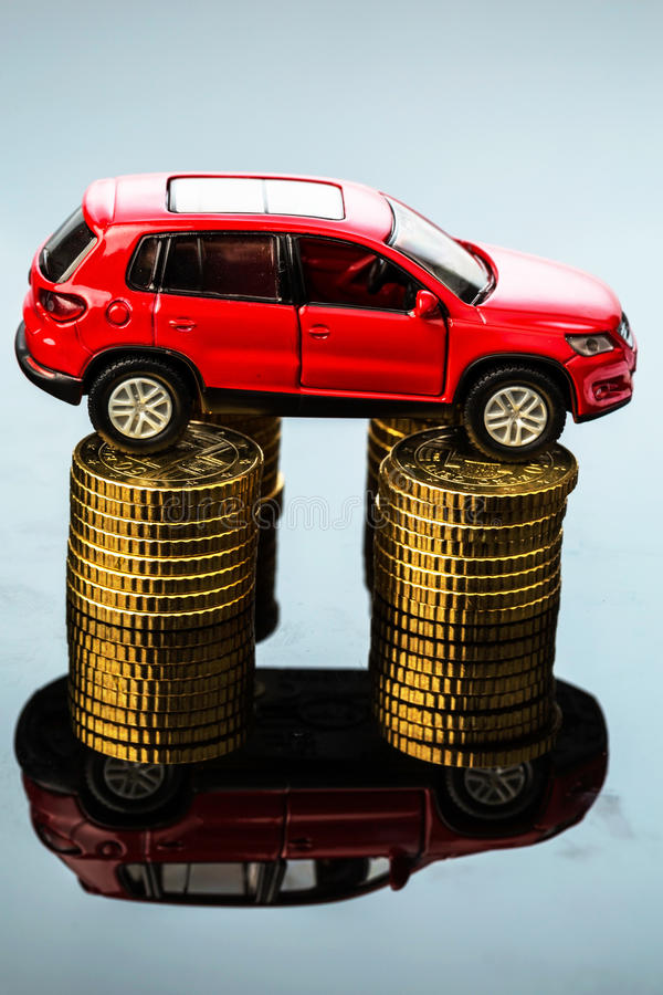 Rising car costs. car on coins. Increasing costs for the car through workshop costs stock photography
