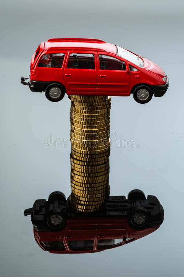 Rising car costs. car on coins. Increasing costs for the car through workshop costs stock images