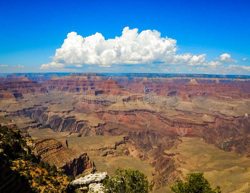 Rising Clouds and Deep Blue Sky Over Grand Canyon. This amazing photo was captured in Grand Canyon in Flagstaff Arizona royalty free stock images