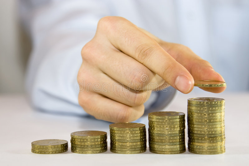 Rising Coins royalty free stock image