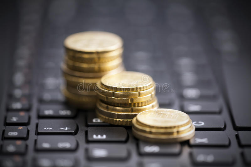 Rising coins on keyboard stock photo
