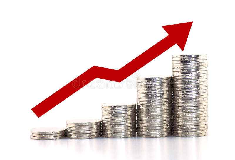 Rising coins. Silver coins piled up displaying a growing chart with a arrow up stock photo