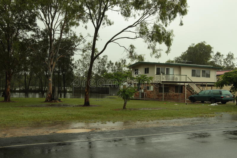 Rising flood water Rothwell home. BRISBANE, AUSTRALIA - JAN 25 : One year on Brisbane flooding again, rising flodd water at Rothwell home January 25, 2012 in royalty free stock photos