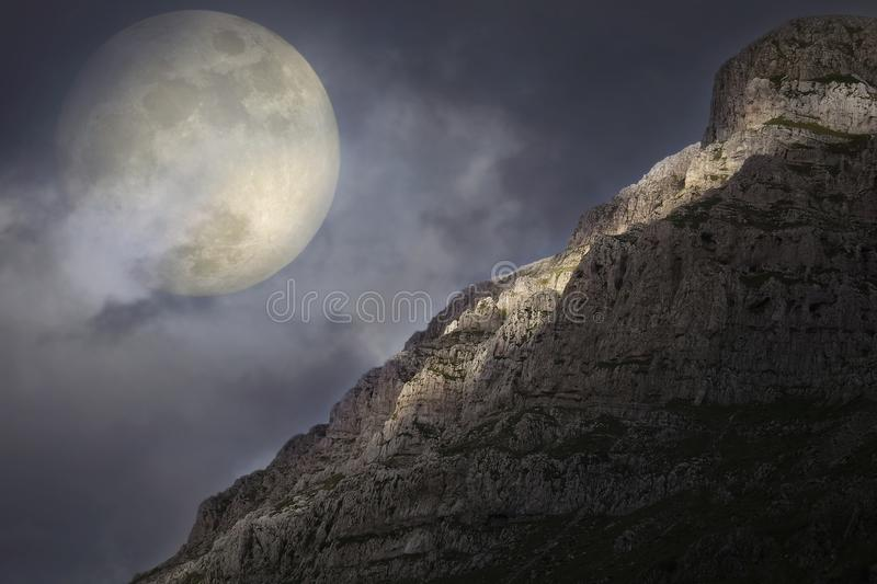 Rising full moon over the rocky summit royalty free stock photos