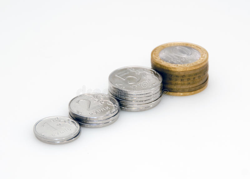 Rising income. Some piles of coins.