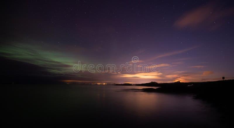 Rising moon over Atlantic Ocean Road in Norway royalty free stock photo