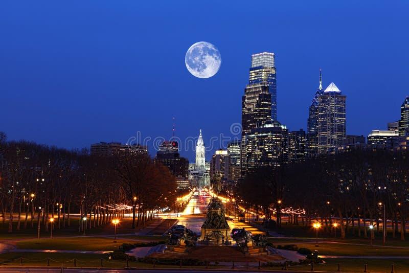 Rising moon over Philadelphia, Pennsylvania stock photos