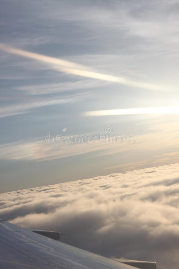 Rising over the clouds stock photo