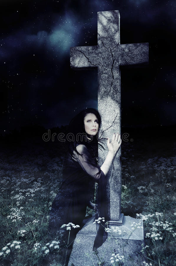 Female Ghost. The spirit of a lady arises from her grave royalty free stock images