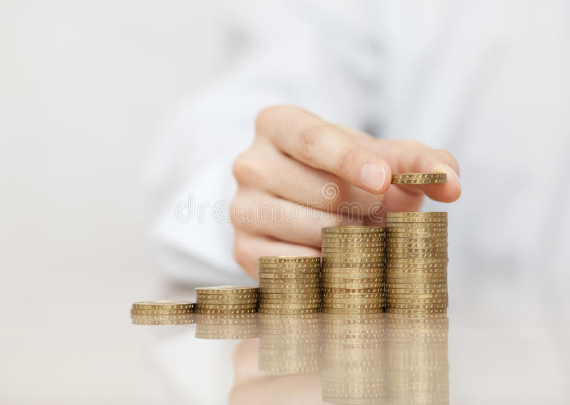 Rising stack of coins stock photography