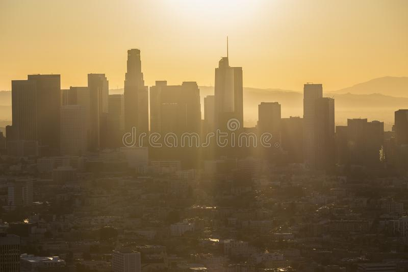 Rising Sun Above Downtown Los Angeles. Aerial morning view of rising sun above downtown Los Angeles in Southern California royalty free stock images