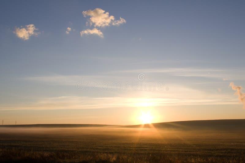 Rising sun beams stock photo